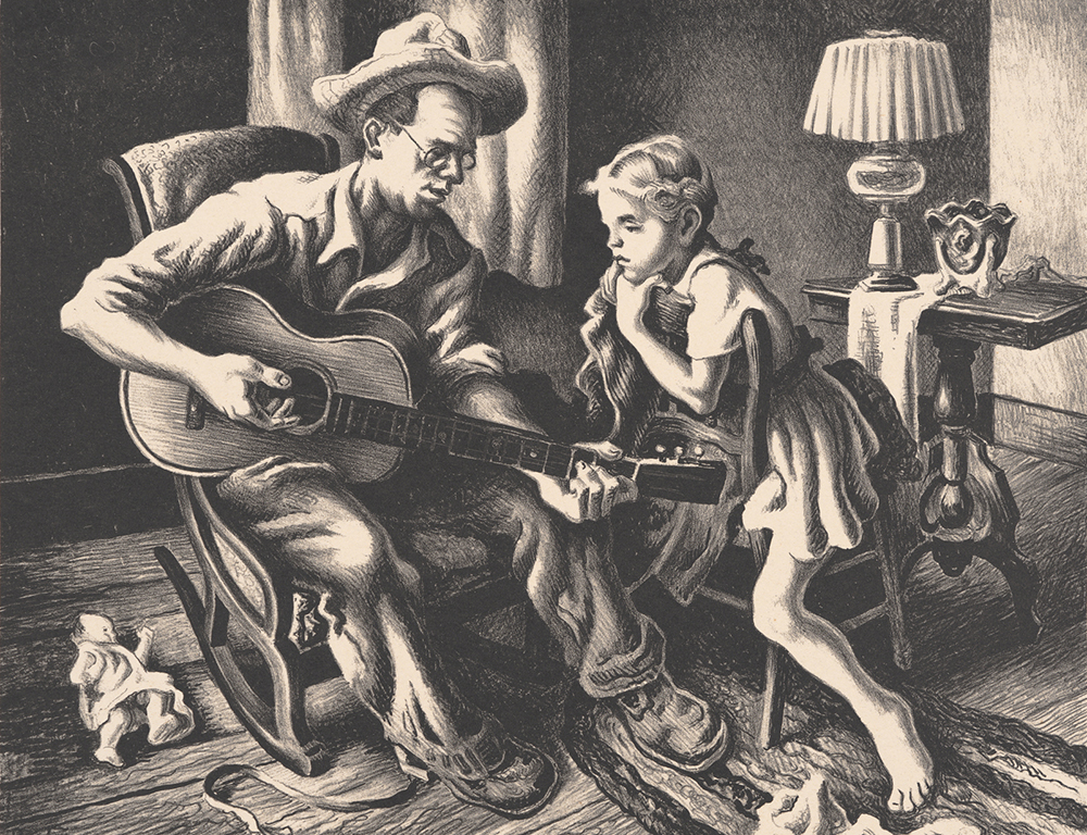 Man playing guitar for child