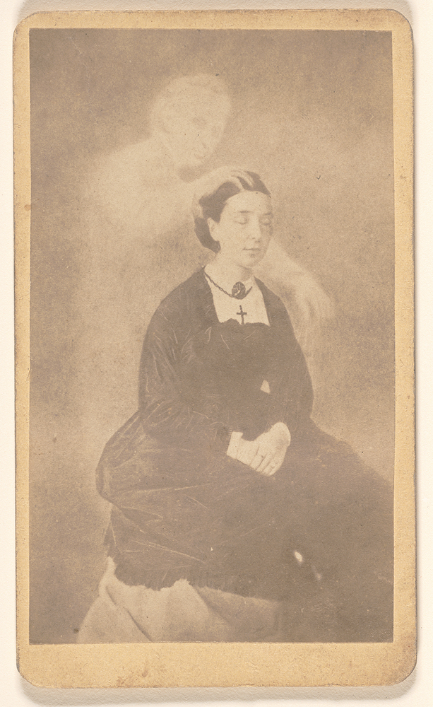 Seated woman with eyes closed and ghost
