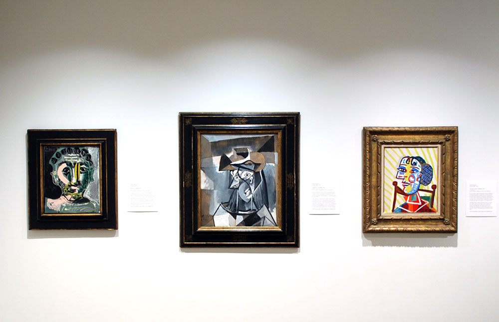 Three Picasso paintings hanging on a wall