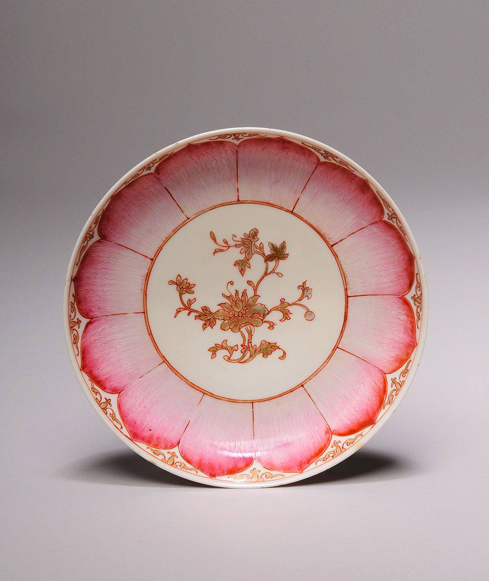 Ceramic plate with pink and gold painting decoration