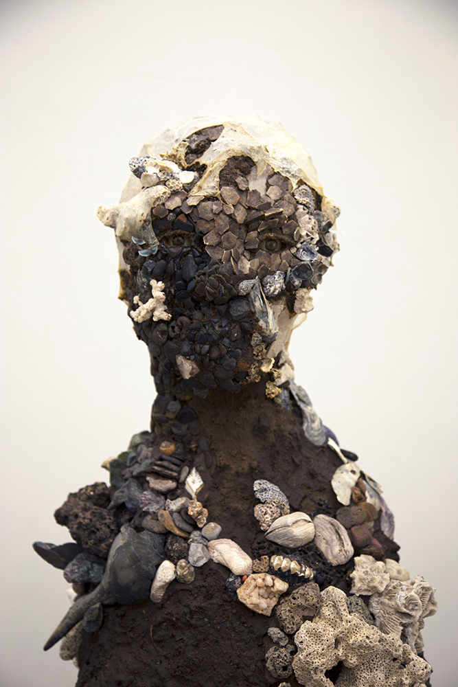 Sculpture of person's head and shoulders