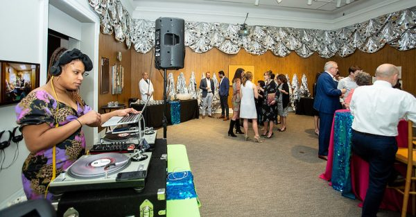 A DJ plays music in the Ackland's Art& event space