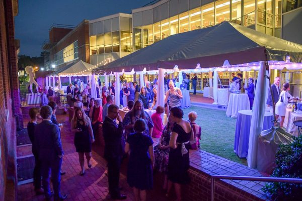 The Ackland courtyard set up with tents and tables and filled with party guests at the Museum's 60th Birthday event