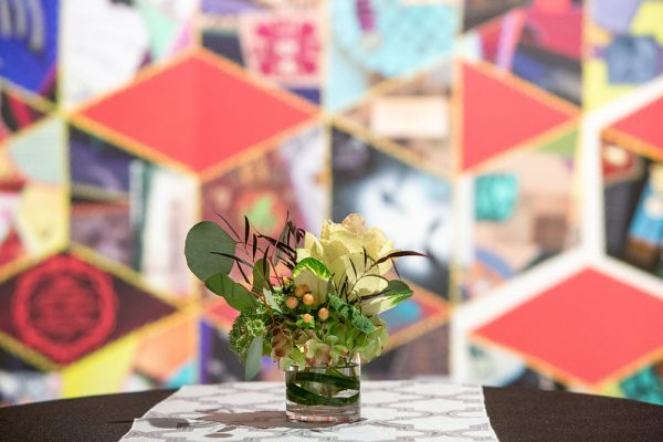 A flower arrangement on a table in the Ackland's Art& event space