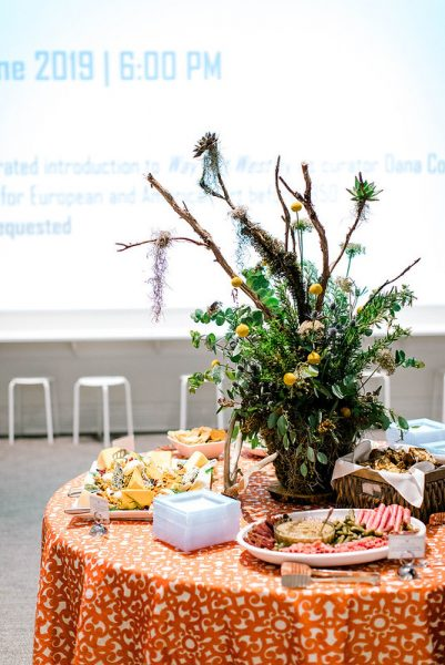 A flower arrangement on a table in the Ackland's Art& space
