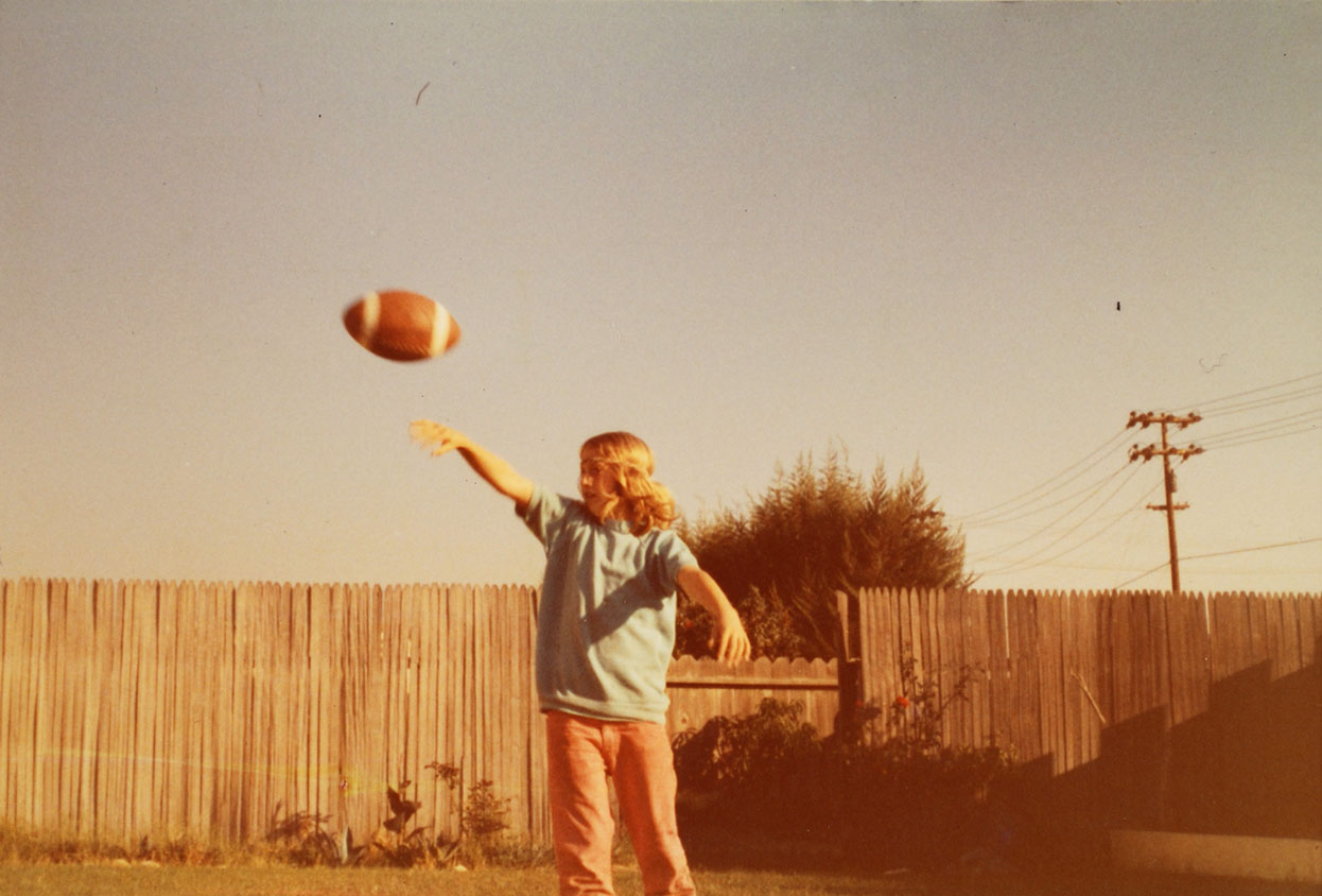 Snapshot of a child throwing a football