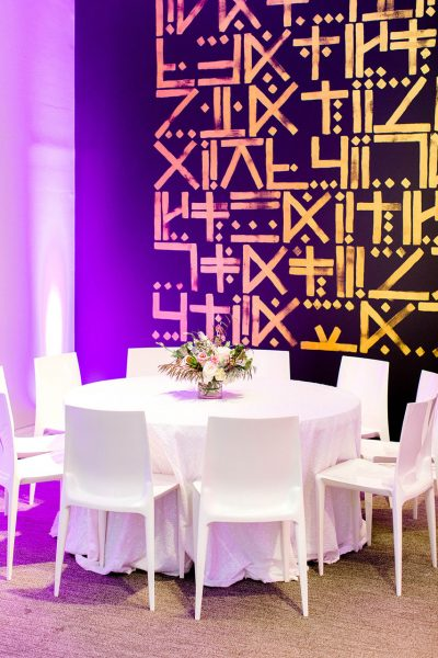 A formal table setting in the Ackland's Art& space - an event venue with rotating contemporary art installations