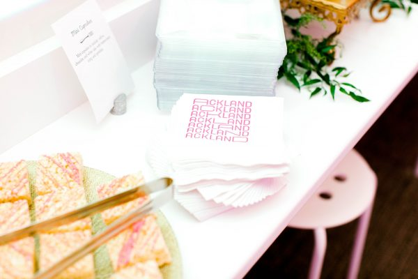 A serving counter with Ackland branded cocktail napkins