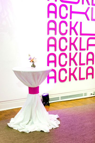 A cocktail table with formal linens in the Ackland lobby for an event