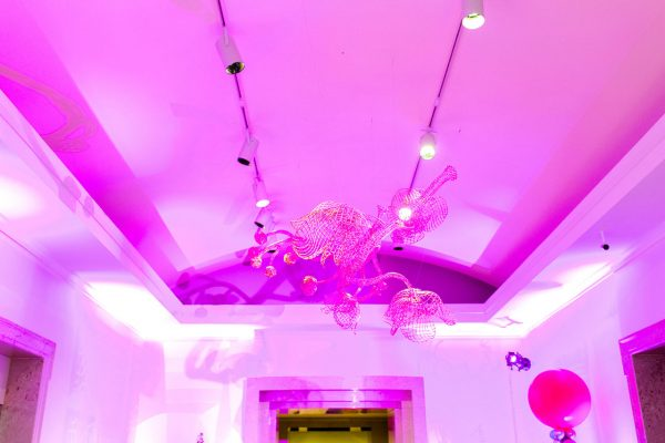 Art suspended from the ceiling in the Ackland's lobby event space