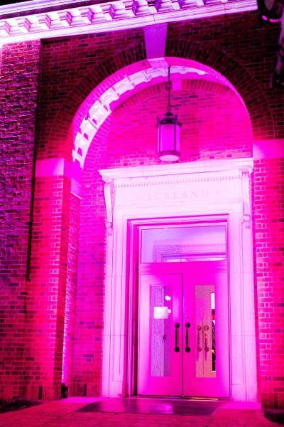The Ackland front door lit with pink up-lighting