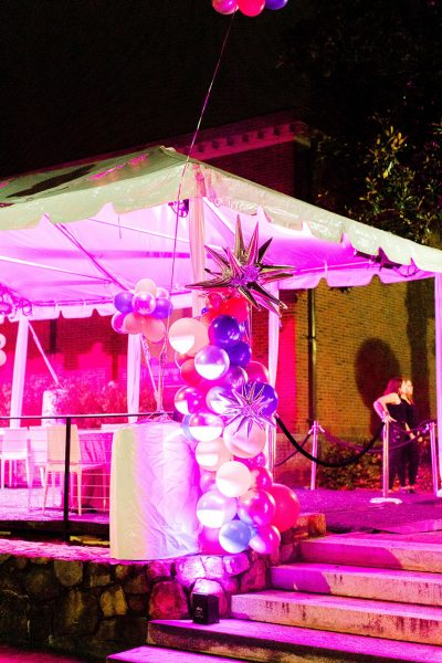 Exterior event space - A large balloon arrangement beside a tent on the Ackland terrace