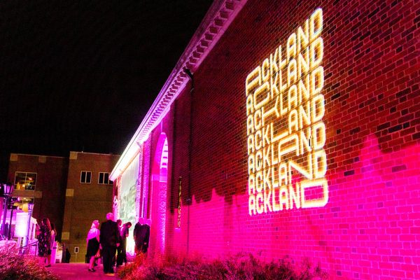 The Ackland logo projected onto the building facade with lights