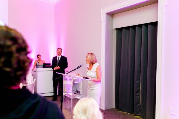 Ackland director Katie Ziglar addressing a crowd in the Museum's Art& space at a Museum event