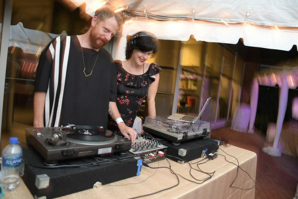 DJs behind table at one of the museum's outdoor event venues
