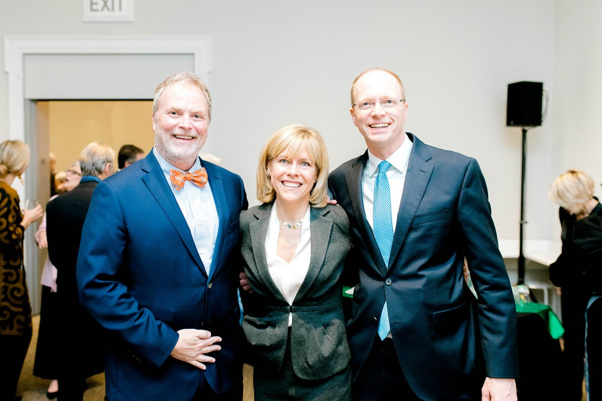 three people from Bank of America smile in an art museum gallery