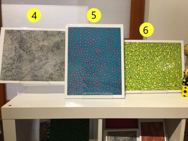 three Yayoi Kusama prints from the gift shop