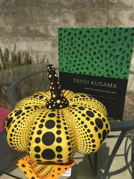 Yayoi Kusama catalog and pumpkin from the gift shop