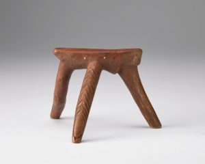 carved wood three legged neck rest