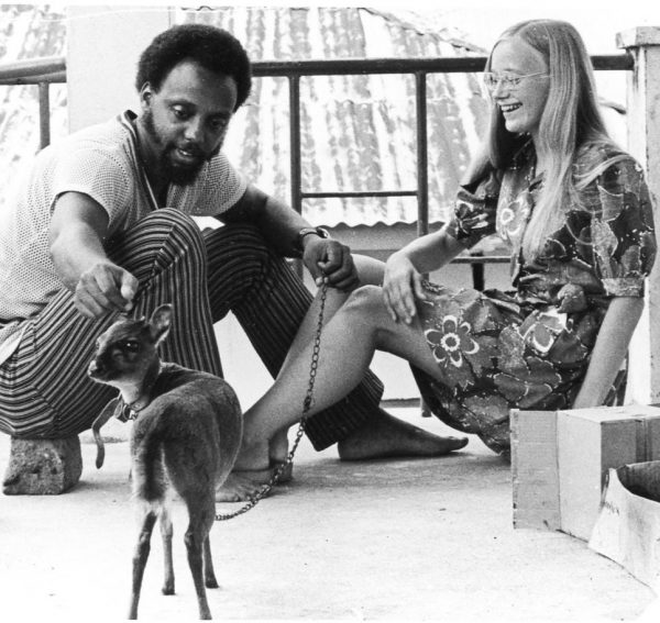 A man and a woman with a small animal