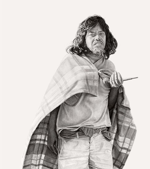 A man with dark shoulder-length hair dressed in a t-shirt, white cutoff shorts, and slippers wears a blanket as a cape
