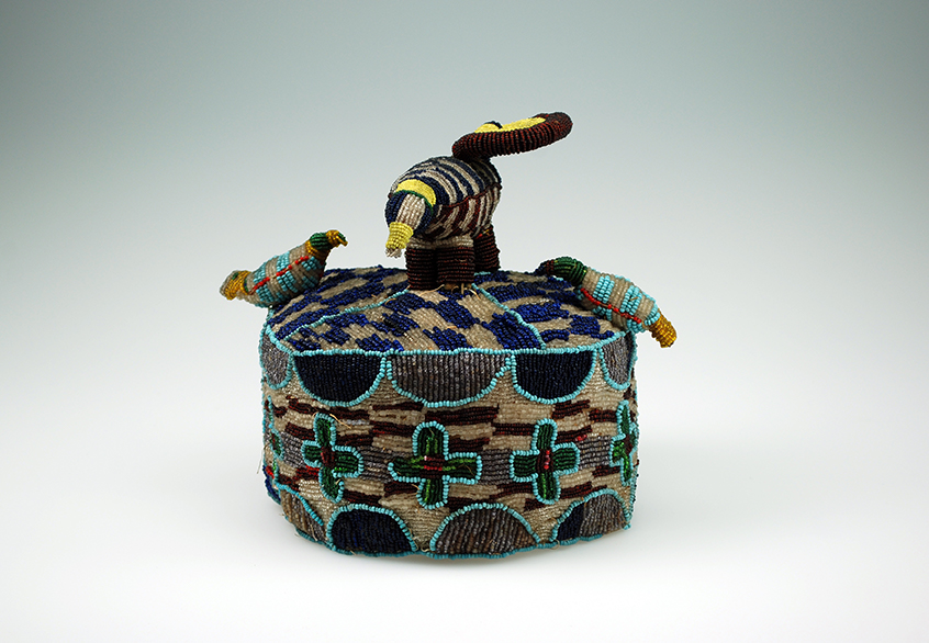 A multicolor beaded cap with three beaded birds on top