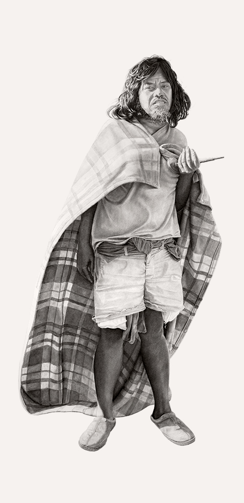 A man with shoulder-length straight black hair and dark skin stands with a billowing blanket worn as a cape, wearing white jean shorts and a t-shirt and holding a small model of a building in one hand.